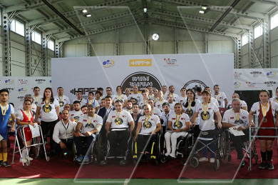 Disabled athletes participating in the bench-press competition