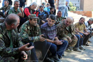 ARF Dashnaktsutyun volunteers gathered near Aram Manukyan statue, waiting for the instruction of the Defense Minister