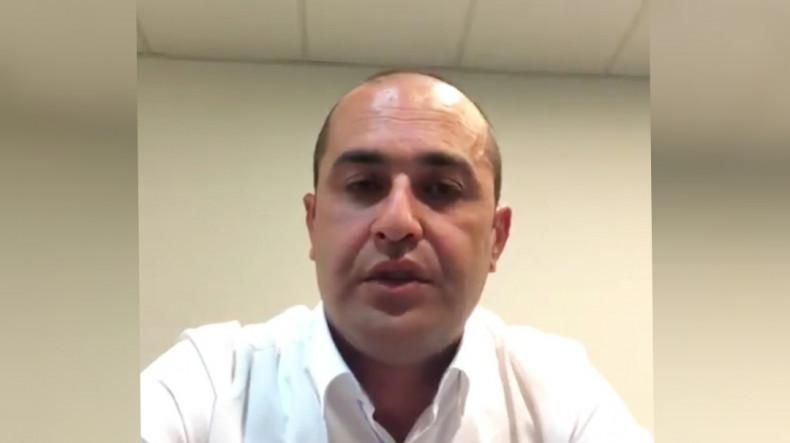 ԱԱԾ աշխատակիցները փորձում են խուզարկել Ucom-ի նախկին տնօրեն Հայկ Եսայանի աշխատասենյակը